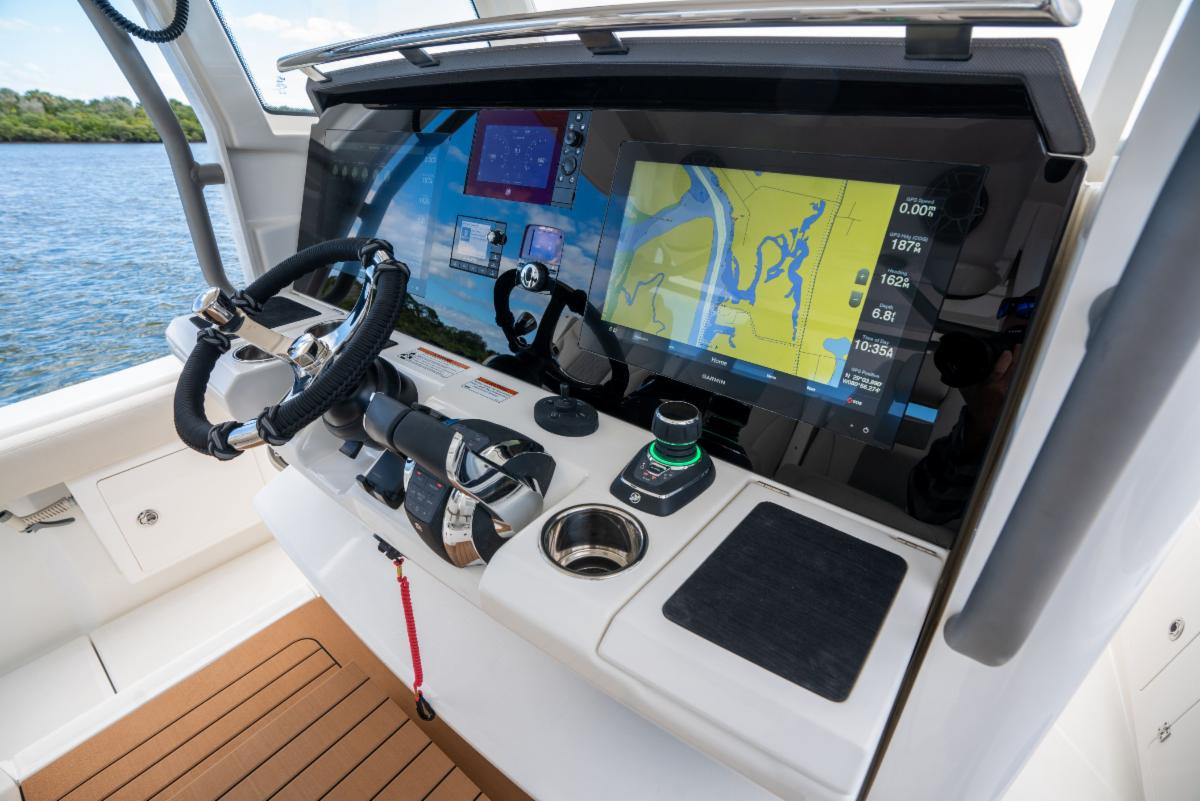 SŌLACE Boats helm aboard the 345 center console. Glass display with twin multifunction garmin displays.