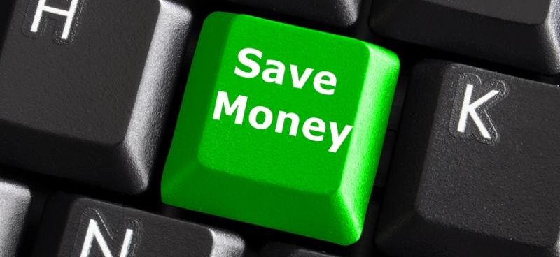 save money for investment concept with a green button on computer keyboard