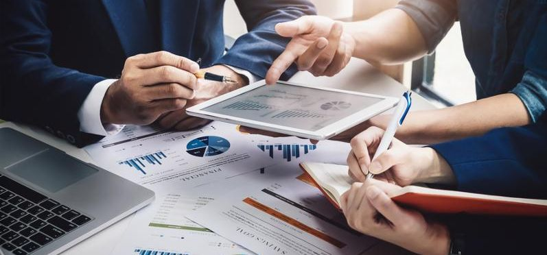 Business Finance_ accounting_ contract_ advisor investment consulting marketing plan for the company with using tablet and computer technology in analysis.