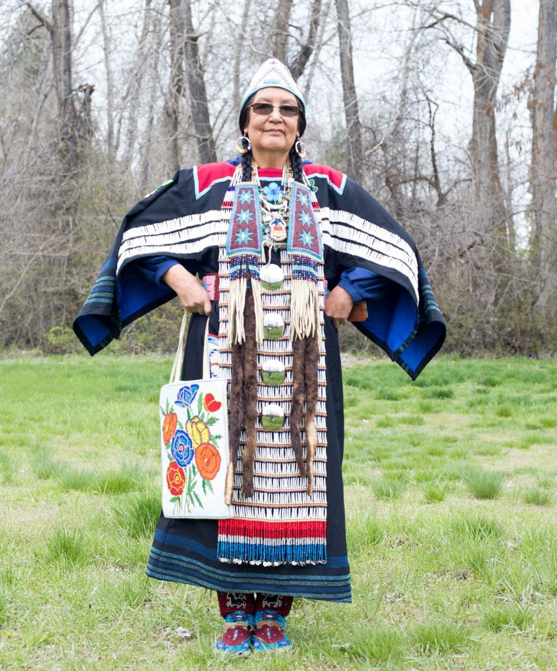 Roberta J. Kirk wearing one of her traditional Plateau Shell dresses