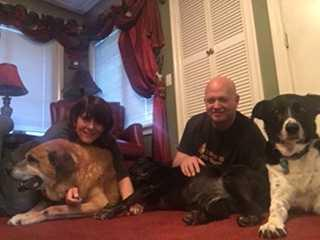 Pictured is Pamela and Jeff Rademaker and their three adopted furry friends
