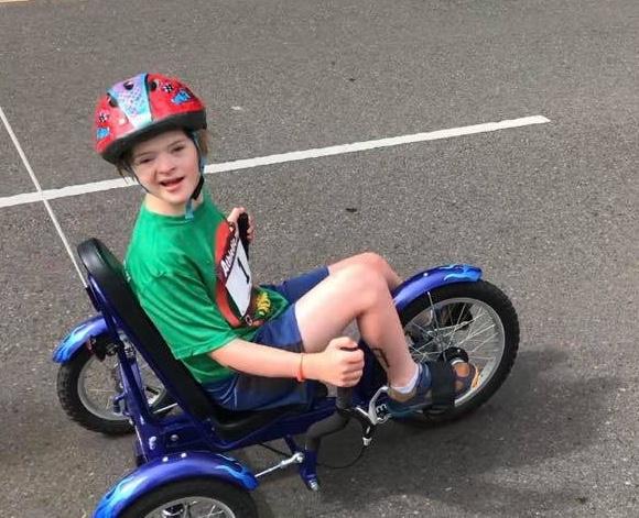 Boy on adaptive bike