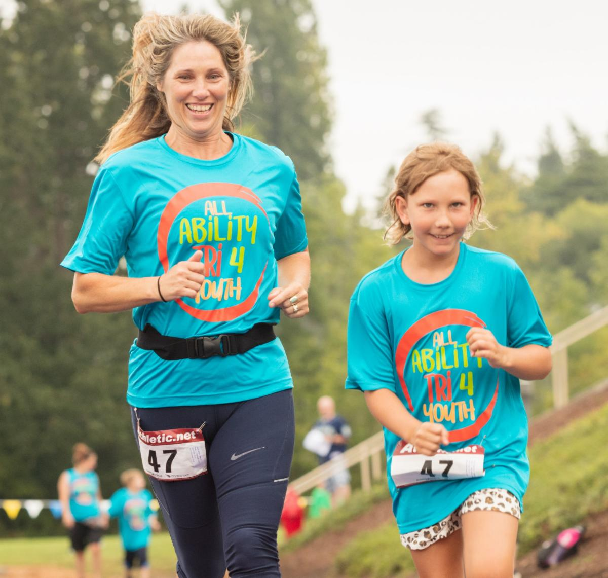 Woman and girl running together