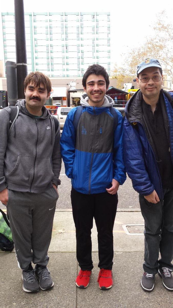 Three young men from the Portland State University Career and Community Studies program standing together and smiling for a photo