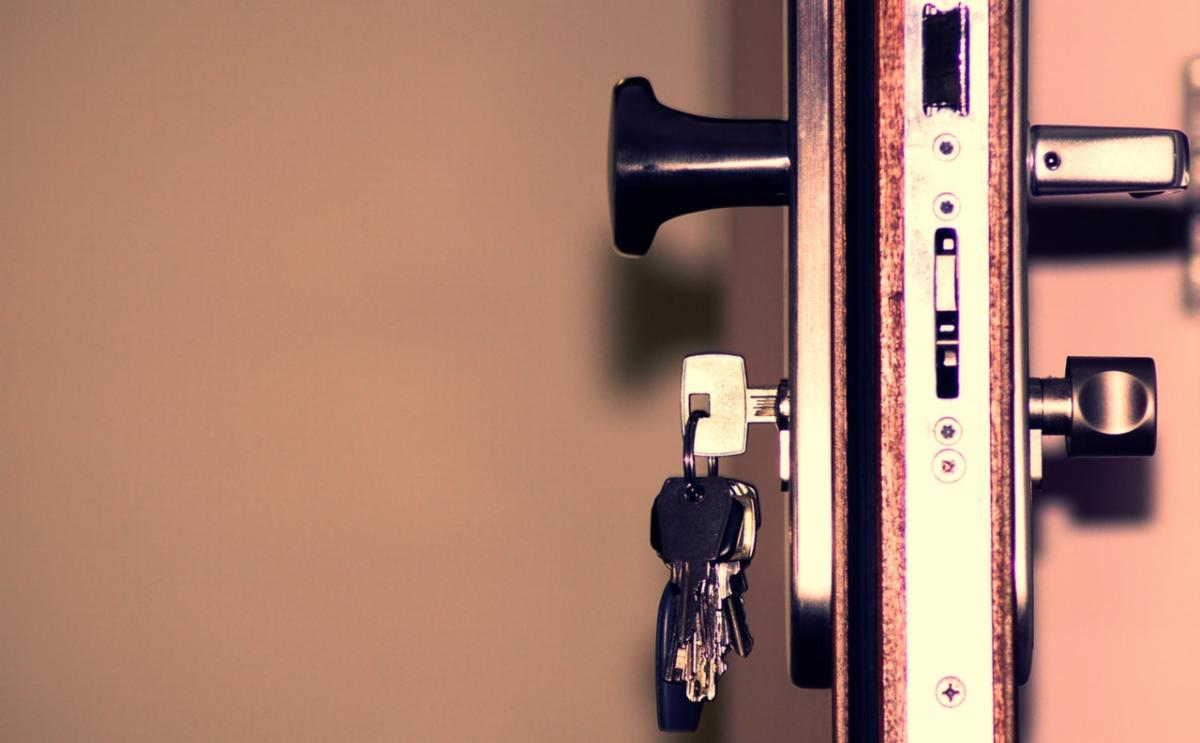 Profile of door with keys dangling from lock