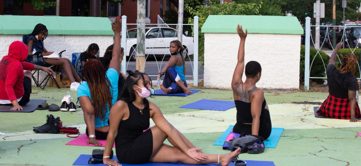 Practicing yoga at the West Philly Healing Circle