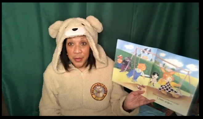 woman reading a children's book
