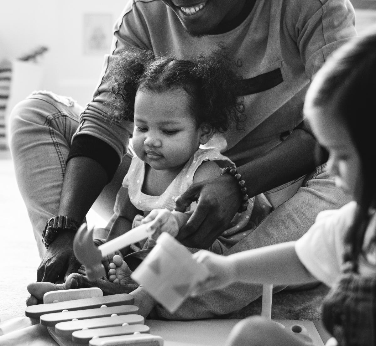 Young Child Playing Xylophone