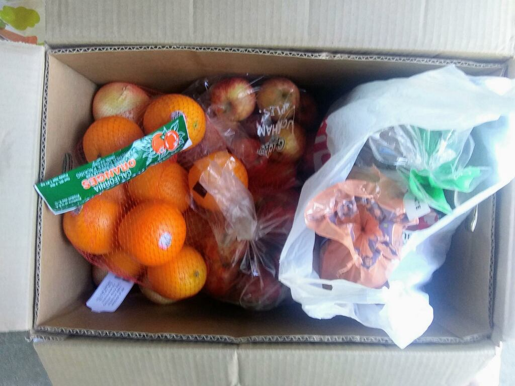 box of food with oranges_ onions_ potatoes and more