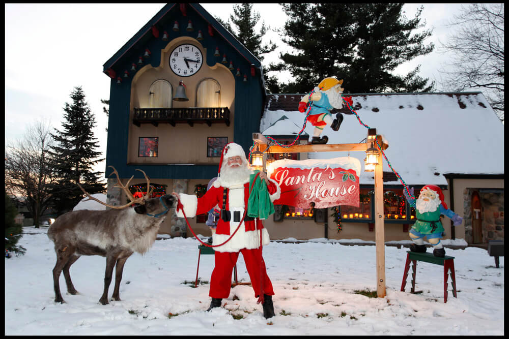 santa with a reindeer outside the midland santa house