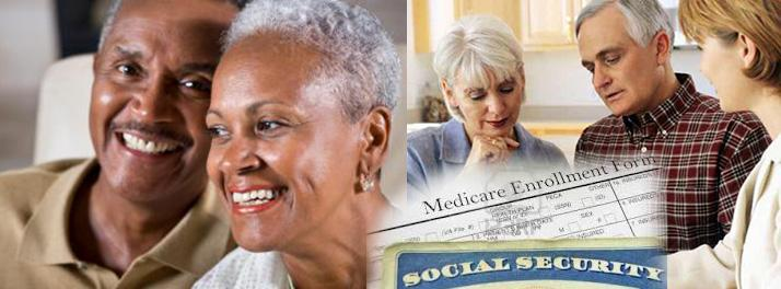 african american and caucasian couples looking over medicare enrollment forms