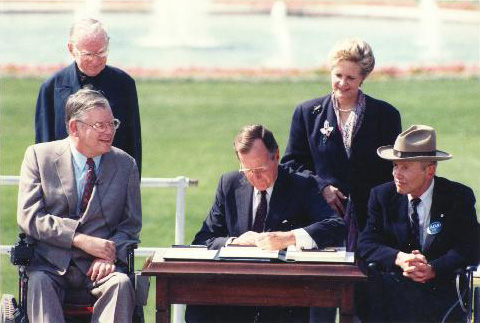 President George Bush signing the ADA on the White House Lawn