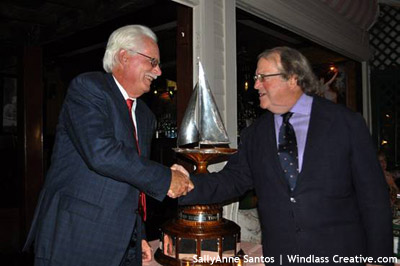 Dennis Williams accepts Ted Turner Trophy from Commodore James Gubelmann