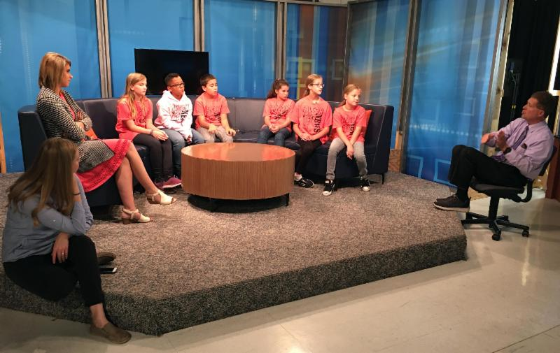 Kids and anchors on WFIE set
