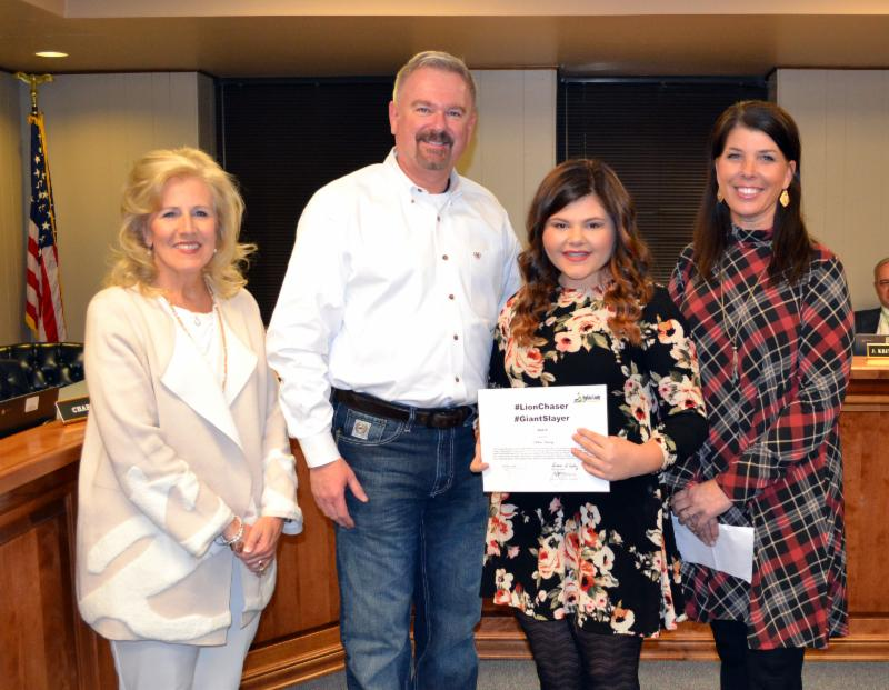 Chloe Young receives certificate_ with Superintendent Ashby_ board Chair J.W. Durst_ and South Hopkins Principal Jan Richey