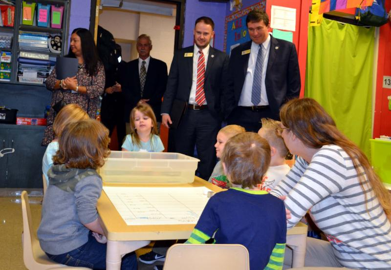 Education Commissioner Pruitt and another KDE administrator observe science class at Earlington Elementary.