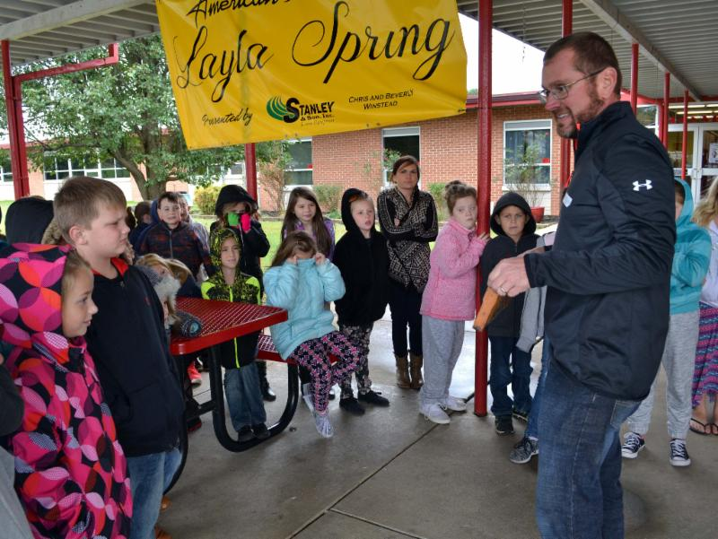 Shawn Brumfield gives bee hive observation talk to group of students