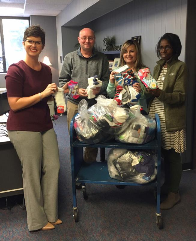 FRYSC coordinators with sacks of donated items