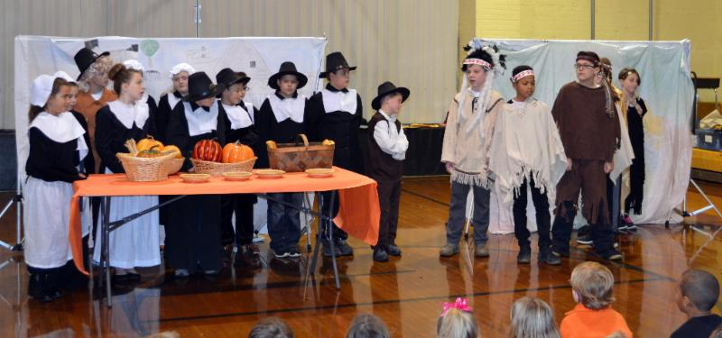 Students dress as pilgrims and Indians for Thanksgiving play