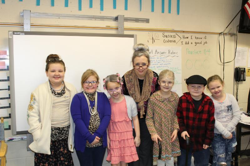 Teacher with six students dressed up as 100-year-olds for 100th day of school