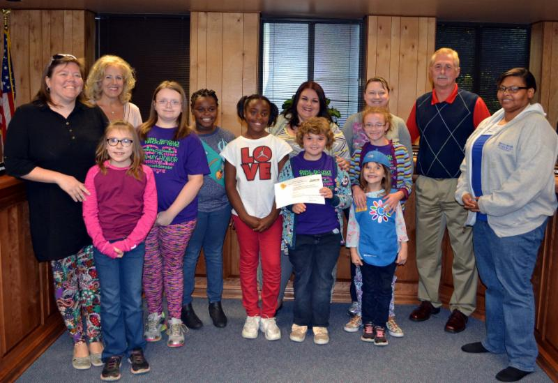 Earlington Girl Scouts with leaders_ superintenent and board president