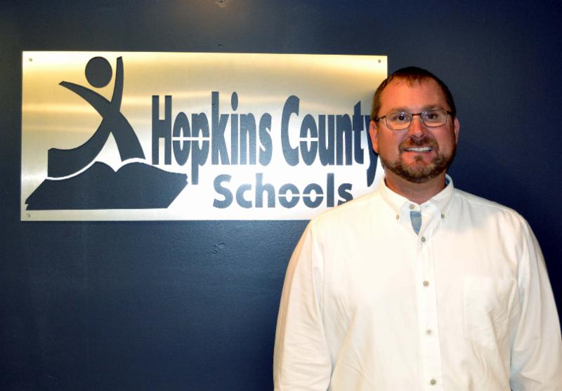 Shawn Brumfield stands in front of Hopkins County Schools sign