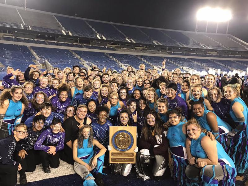 Band members pose with trophy