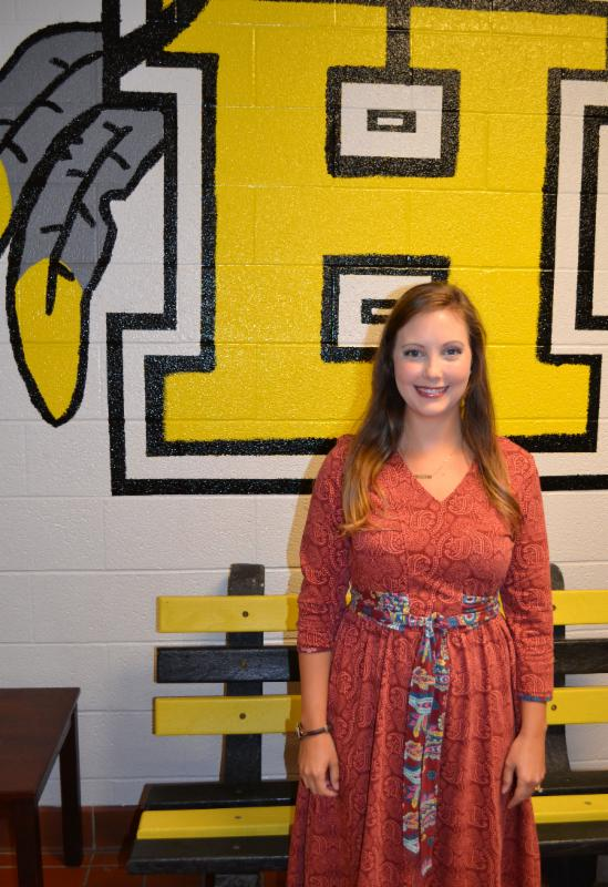 Amy Mullins stands in front of painted _H_ at Hanson school