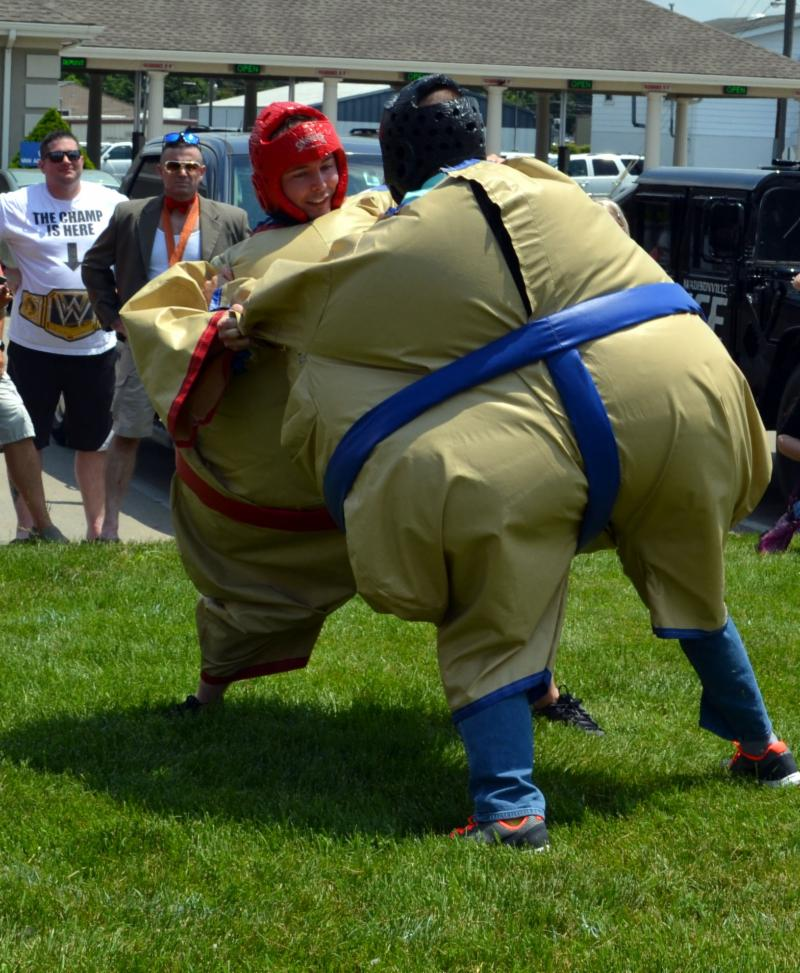 Two wrestlers in sumo costumes