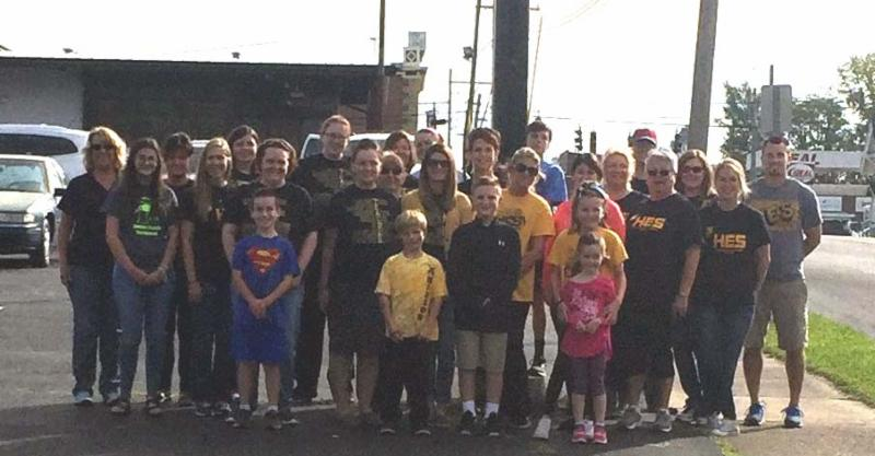 Group photo of Hanson staff and students outside Breaking Bread.