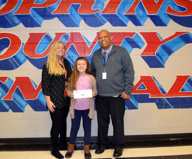 HCCHS teacher Allison Starks_ her daughter_ Mary Grace_ holding presented check in envelope_ and Assistant Superintendent Charles Gant