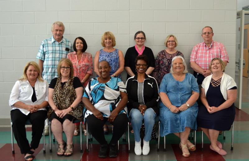 Twelve district retirees post for group photo