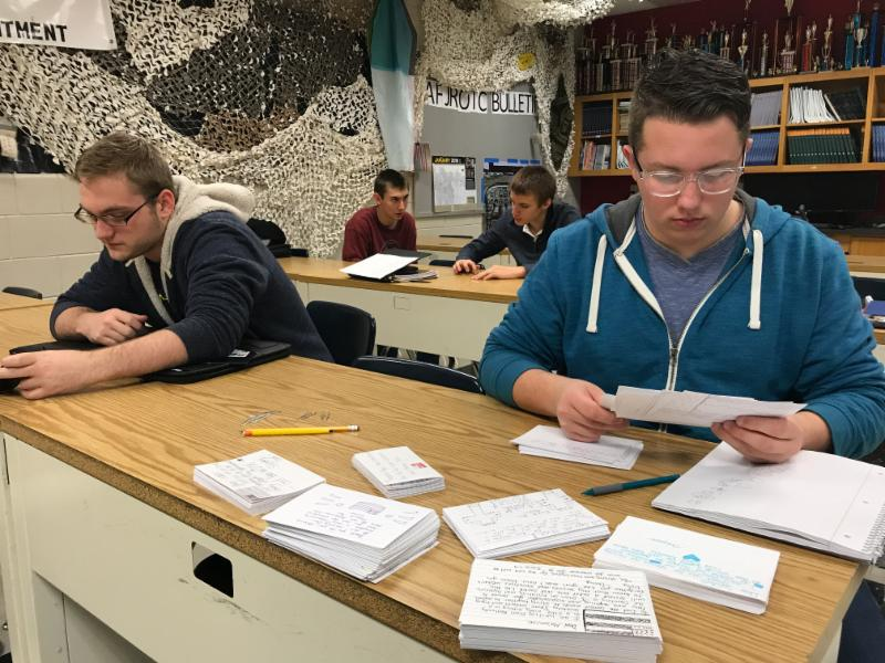 JROTC cadets review letters before sending them