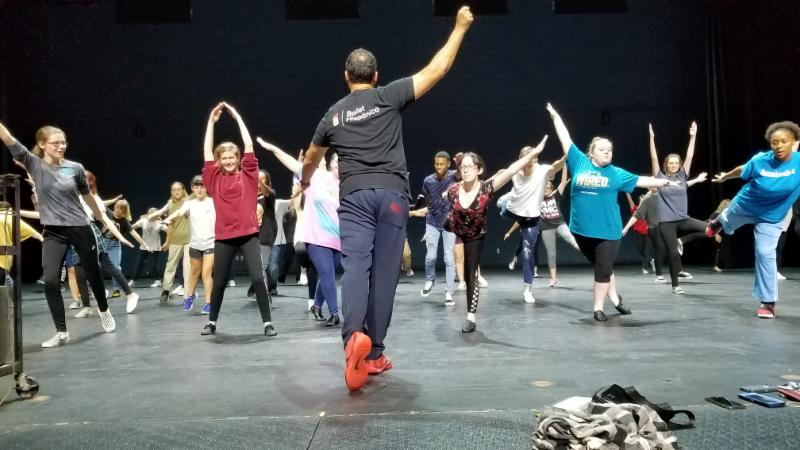 Students on stage for dance workshop