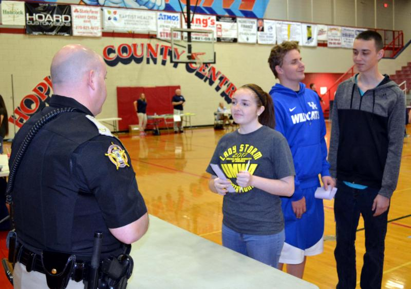 Students wait at law enforcement booth