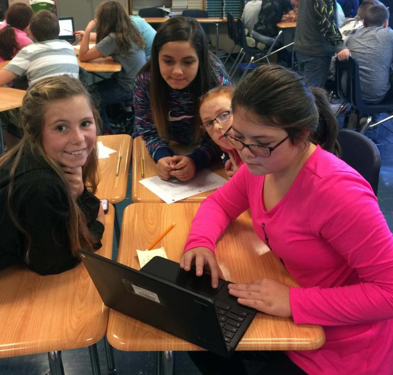 Four students on laptop for escape room project