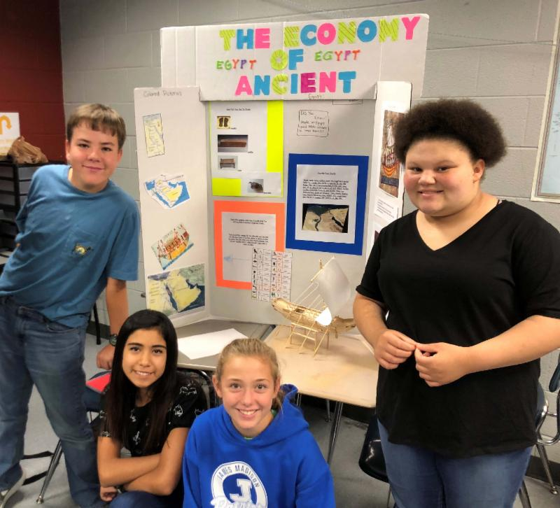Four students pose with Egypt project