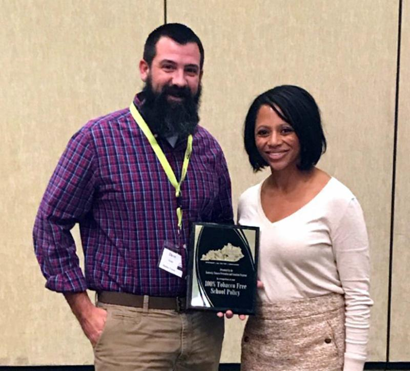 Dave Starks receives Central_s award.