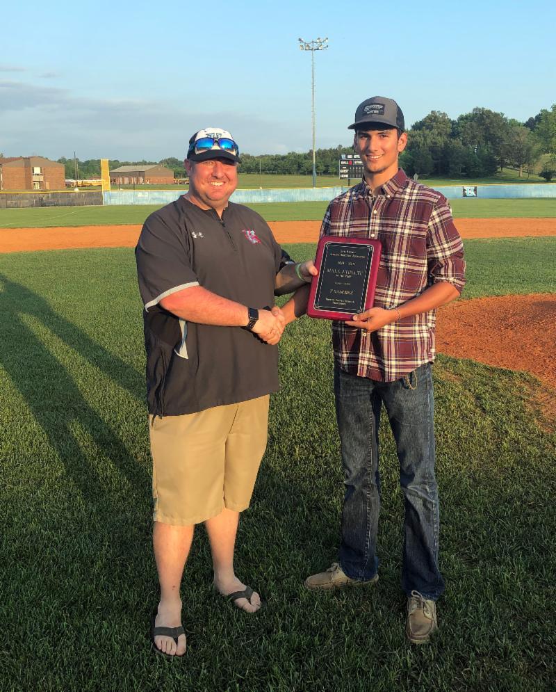 T Sanchez receives award on ball field
