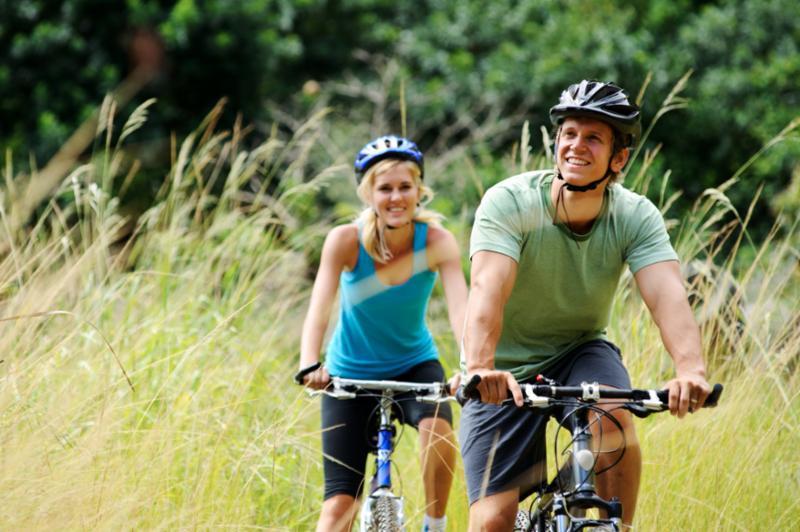 happy_couple_riding_bikes.jpg