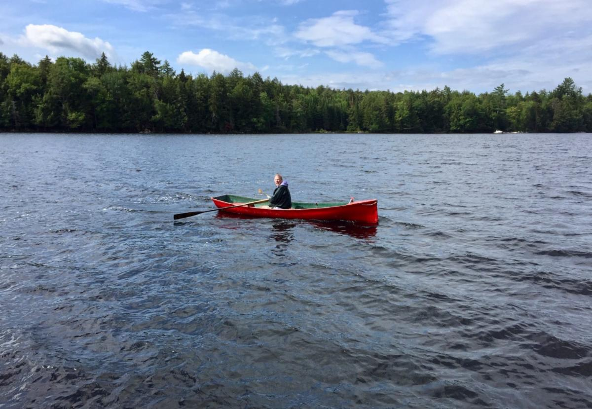 John in canoe - Baekeland Camp