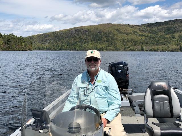 Don Kleiner in a boat