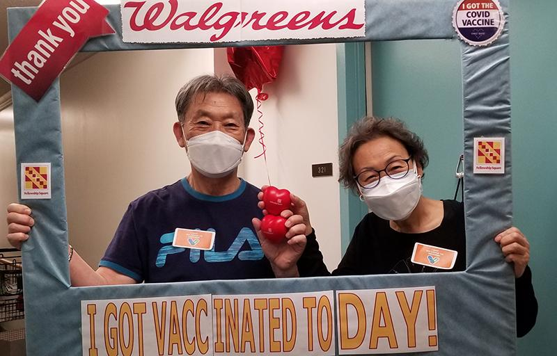 two residents in masks in frame with Walgreens logo and message I got vaccinated today