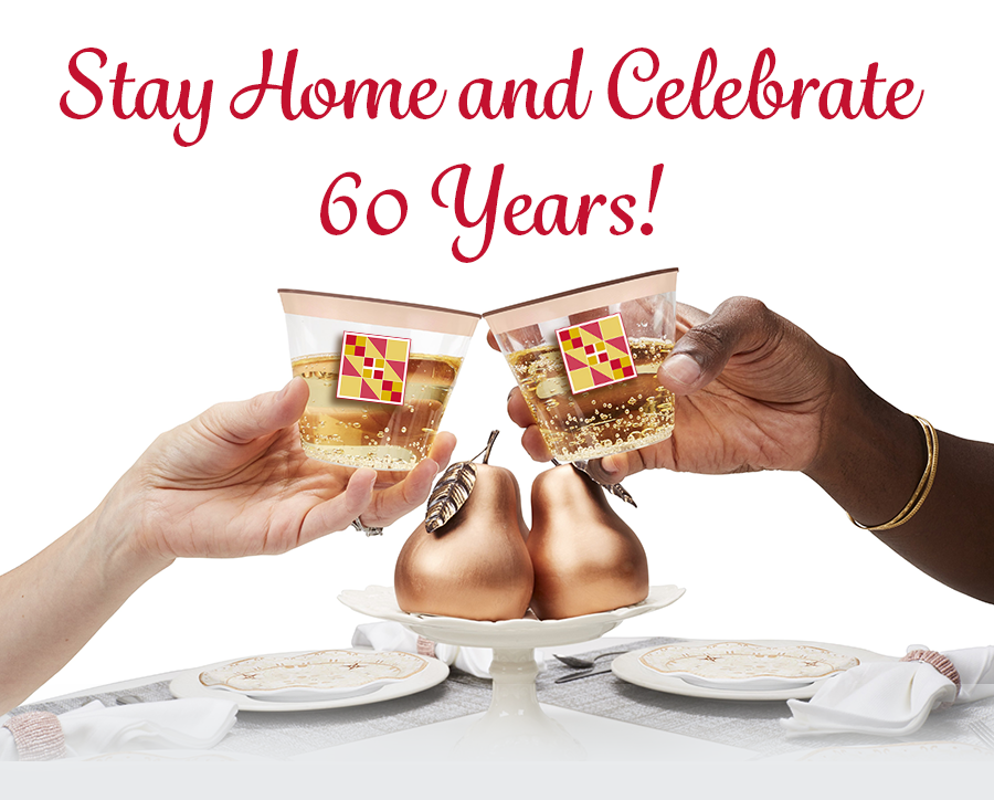 2 glasses in hands toasting with words stay home and celebrate 60 years