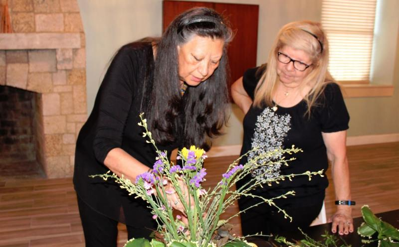 Photo of women arranging flowers at Perrine Community House