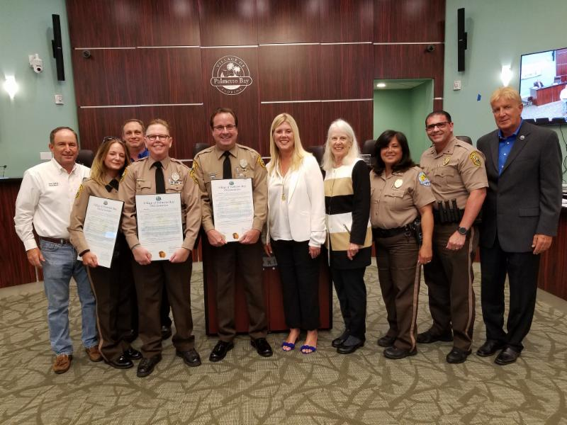 Photo of retiring MDPD OfficersYanes, Sullivan and Stuver with Mayor and Council