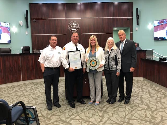 Photo of Retiring Miami Dade Fire Chief Dave Downey, along with mayor and council