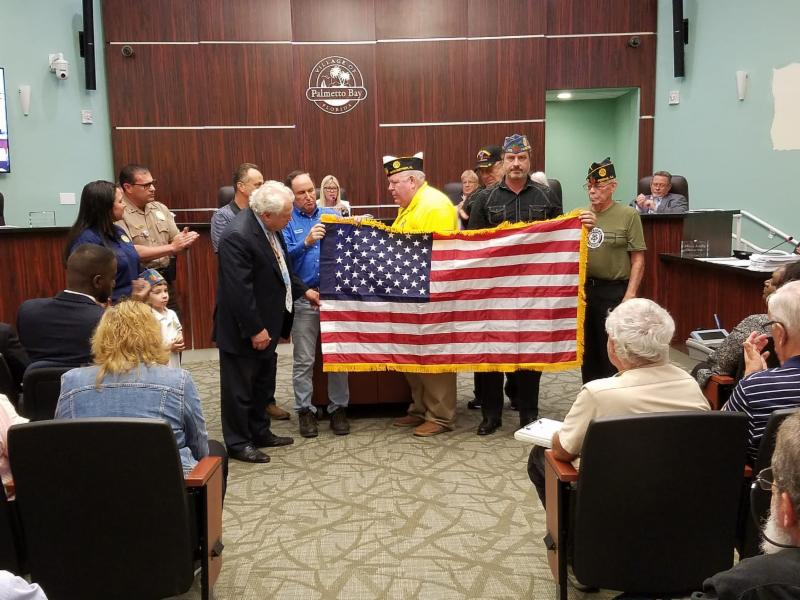 Members of the American Legion present a new American Flag to the Village of Palmetto Bay on Monday night, April 22nd at Village Hall.
