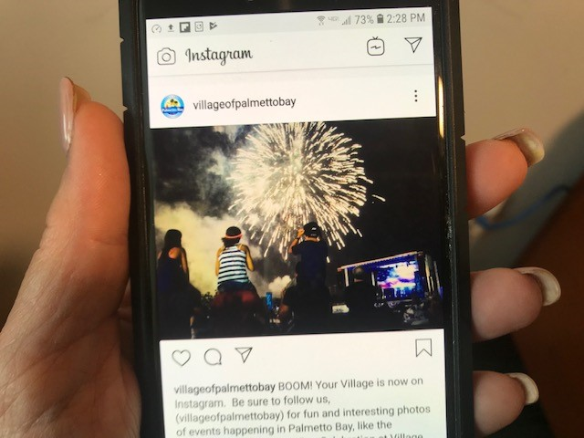 Photo of cellphone with village of palmetto bay page showing in the Instagram app.