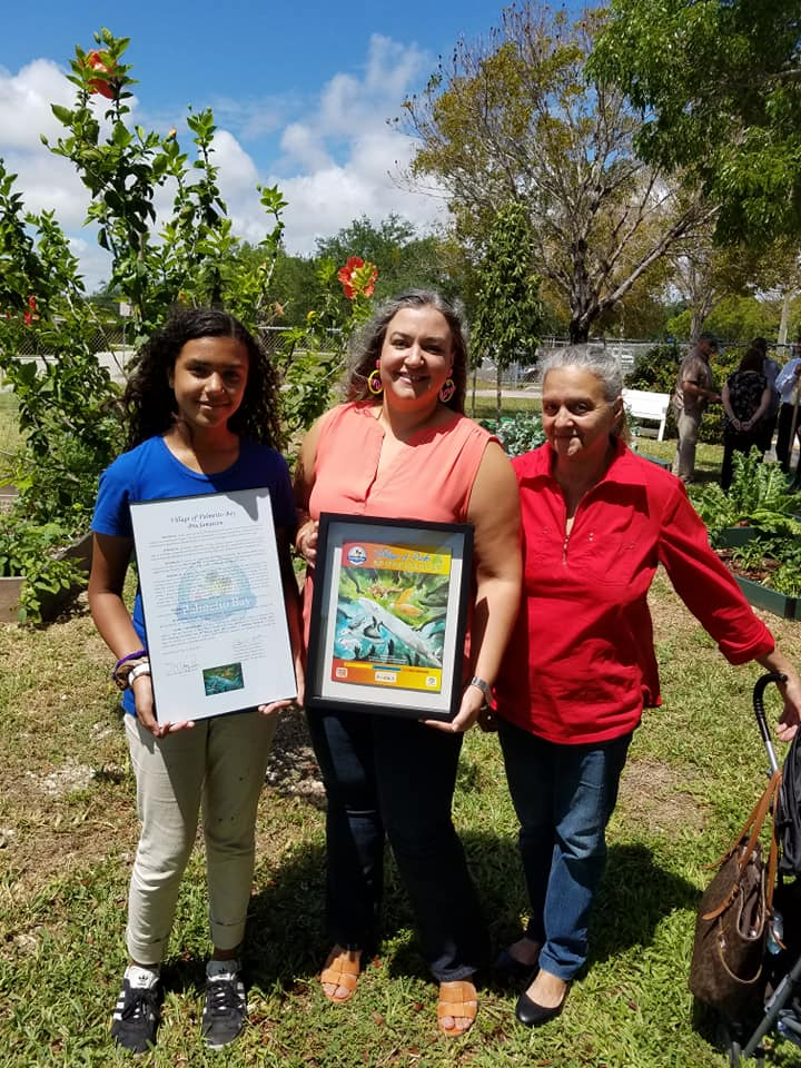 Earth week art winner Amelia Ovalle and her family pictured with awards